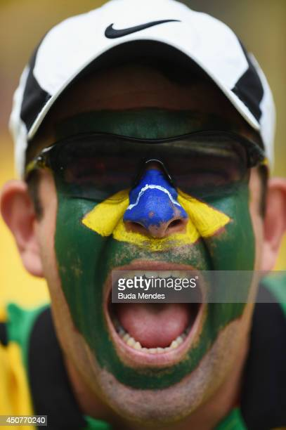 Brazil fan cheers before the 2014 FIFA World Cup Brazil Group A match between Brazil and Mexico at Castelao on June 17 2014 in Fortaleza Brazil