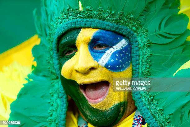 A Brazil fan cheers before the Russia 2018 World Cup quarterfinal football match between Brazil and Belgium at the Kazan Arena in Kazan on July 6...