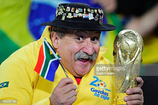 Brazil fan enjoys the atmosphere prior to the 2010 FIFA World Cup South Africa Group G match between Brazil and Ivory Coast at Soccer City Stadium on...