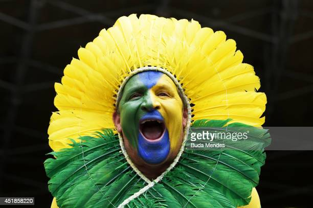 Brazil fan enjoys the atmosphere prior to the 2014 FIFA World Cup Brazil Semi Final match between Brazil and Germany at Estadio Mineirao on July 8...