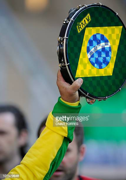 A Brazil fan holds up a tambourine in the design of the Brazilian flag before the opening match of the 2010 FIFA World Cup on June 11 2010 at Soccer...