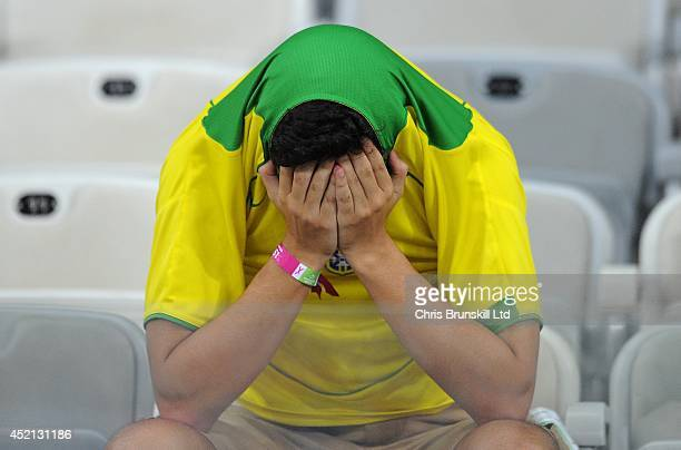 Brazil fan looks dejected following the 2014 FIFA World Cup Brazil Semi Final match between Brazil and Germany at Estadio Mineirao on July 08 2014 in...