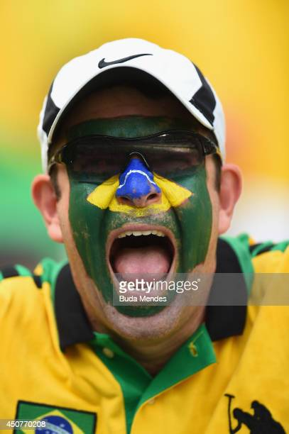 Brazil fan poses before the 2014 FIFA World Cup Brazil Group A match between Brazil and Mexico at Castelao on June 17 2014 in Fortaleza Brazil