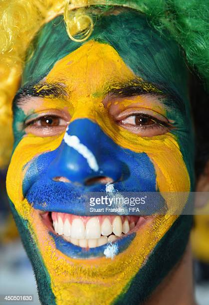Brazil fan shows their support ahead of the 2014 FIFA World Cup Brazil Group A match between Brazil and Croatia at Arena de Sao Paulo on June 12,...
