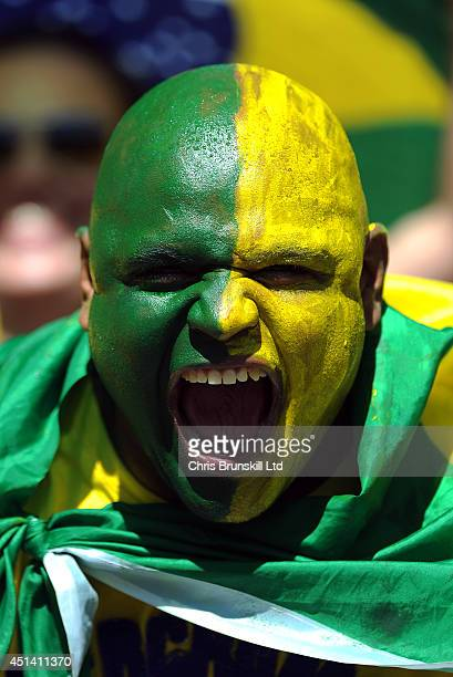 Brazil fan supports his team during the 2014 FIFA World Cup Brazil Round 16 match between Brazil and Chile at Estadio Mineirao on June 28 2014 in...