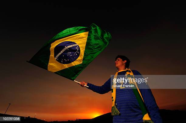 Brazil fan waves her national flag ahead of the 2010 FIFA World Cup South Africa Group G match between Brazil and Ivory Coast at Soccer City Stadium...