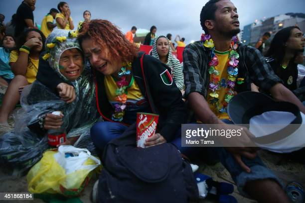 Brazil fans are devastated while watching the first half on Copacabana Beach during the 2014 FIFA World Cup semifinal match between Brazil and...