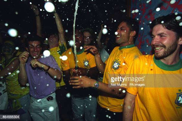 Brazil fans celebrate at the Salsa Club in London's Soho, after watching their team triumph in the World Cup Final against Italy.
