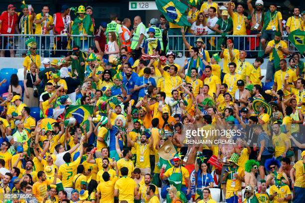 Brazil fans celebrate their team's win after the Russia 2018 World Cup round of 16 football match between Brazil and Mexico at the Samara Arena in...