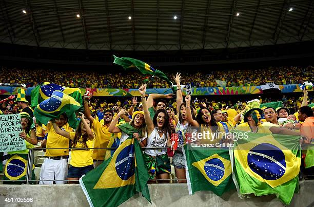 Brazil fans cheer during the 2014 FIFA World Cup Brazil Quarter Final match between Brazil and Colombia at Castelao on July 4, 2014 in Fortaleza,...
