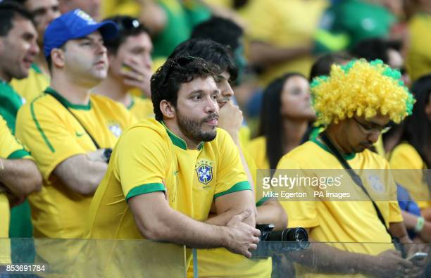Brazil fans dejected in the stands during the FIFA World Cup Semi Final at Estadio Mineirao Belo Horizonte Brazil
