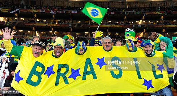 Brazil fans enjoy the atmosphere prior to the 2010 FIFA World Cup South Africa Group G match between Brazil and Ivory Coast at Soccer City Stadium on...