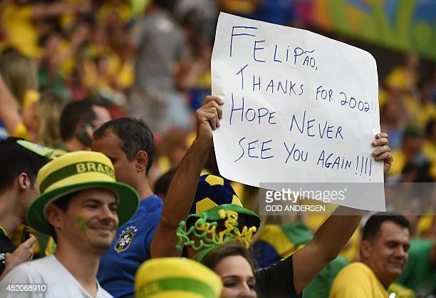 Brazil fans hold up a placard prior to the third place playoff football match between Brazil and Netherlands during the 2014 FIFA World Cup at the...