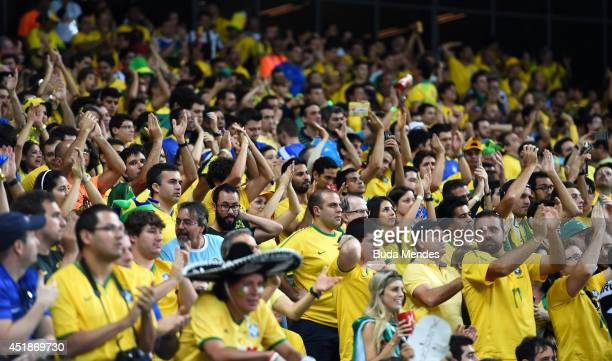 Brazil fans look on during the 2014 FIFA World Cup Brazil Semi Final match between Brazil and Germany at Estadio Mineirao on July 8 2014 in Belo...