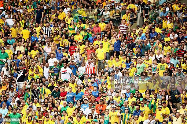 Brazil fans look on during the Women's Football Semi Final between Brazil and Sweden on Day 11 of the Rio 2016 Olympic Games at Maracana Stadium on...