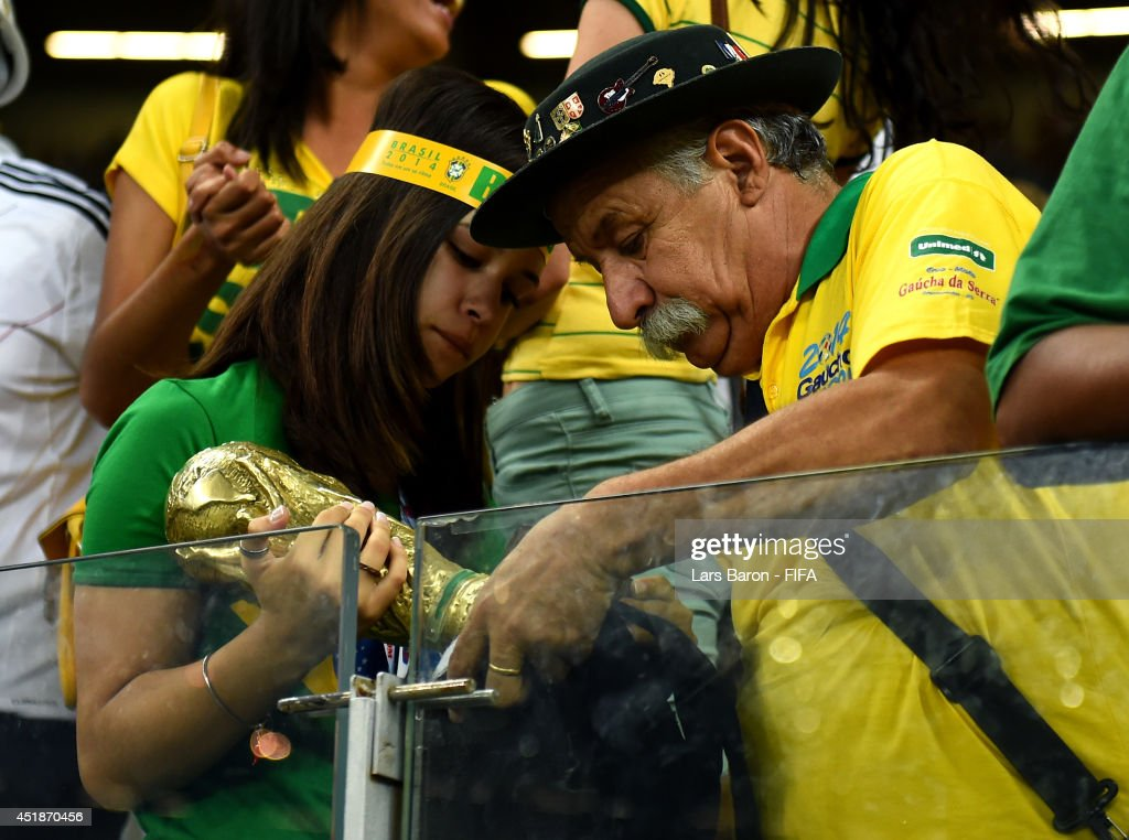 Brazil fans react after the 1-7 defeat in the 2014 FIFA World Cup Brazil Semi Final match between Brazil and Germany at Estadio Mineirao on July 8, 2014 in Belo Horizonte, Brazil.