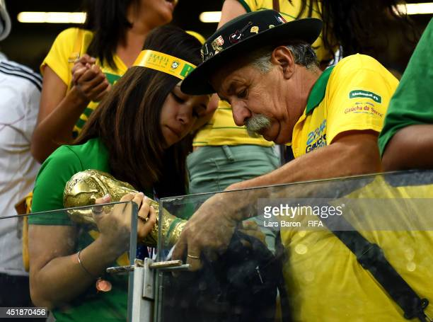 Brazil fans react after the 1-7 defeat in the 2014 FIFA World Cup Brazil Semi Final match between Brazil and Germany at Estadio Mineirao on July 8,...