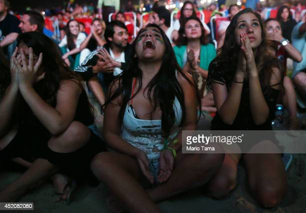 Brazil fans react after the Netherlands scored to take a 30 lead in extra time on Copacabana Beach on July 12 2014 in Rio de Janeiro Brazil Brazil...