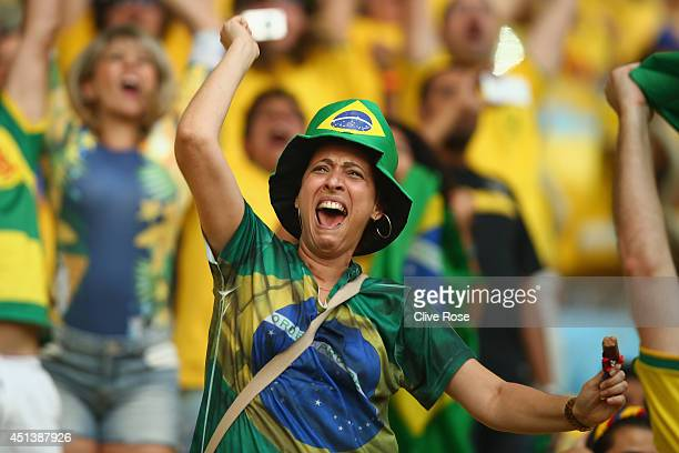 Brazil fans show their emotions as they watch the Brazil and Chile penalty shoot out on the big screen ahead of the 2014 FIFA World Cup Brazil round...