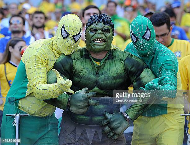 Brazil fans support their team during the 2014 FIFA World Cup Brazil Round of 16 match between Brazil and Chile at Estadio Mineirao on June 28 2014...