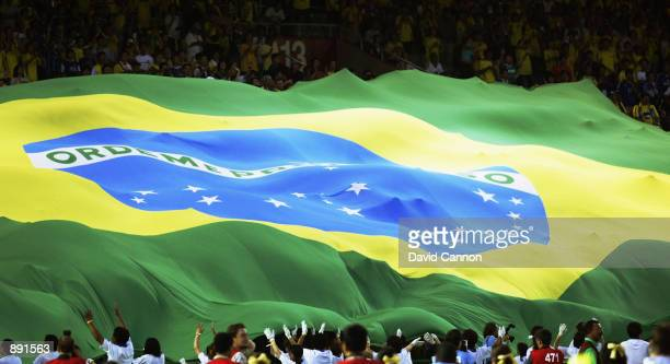 Brazil fans unfurl a giant flag during the Germany v Brazil World Cup Final match played at the International Stadium Yokohama in Yokohama Japan on...