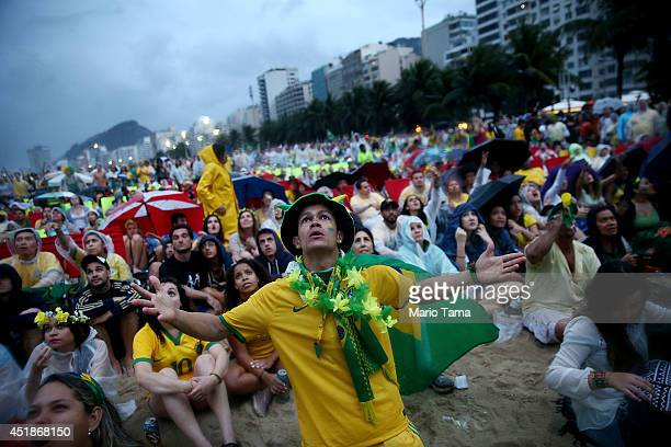Brazil fans watch the first half on Copacabana Beach during the 2014 FIFA World Cup semifinal match between Brazil and Germany on July 8 2014 in Rio...