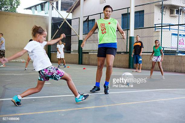 Brazil female Street Child World Cup team training playing football on a concrete pitch in a favela in favela Vila Cruzeiro Vila Cruzerio is one of...