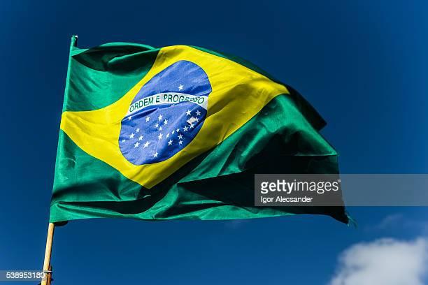 Brazil flag against the blue sky