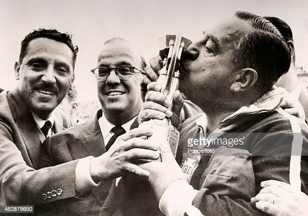 Brazil football coach Vicente Feola kisses the World Cup trophy after Brazil defeated Sweden 52 in the Final in Stockholm on 30th June 1958