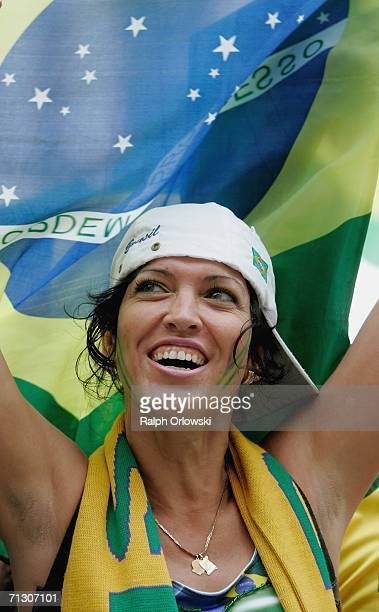 Brazil football fan celebrates the victory of her team on June 27, 2006 in Dortmund, Germany. Brazil won their World Cup match against Ghana 3-0 in...