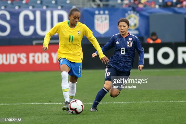 Brazil forward Adriana and Japan midfielder Moeno Sakaguchi during the SheBelieves Cup match between Brazil and Japan at Nissan Stadium on March 2nd...
