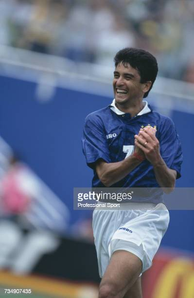 Brazil forward Bebeto pictured celebrating with a 'cradle the baby' hand gesture after scoring a goal in the 1994 FIFA World Cup quarterfinal match...