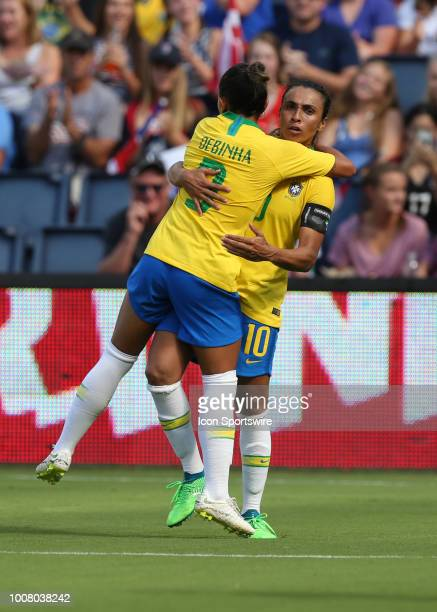 Brazil forward Debinah hugs Marta after Marta assisted Debinah on a goal in the second half of a women's soccer match between Brazil and Australia in...