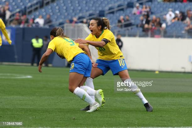 Brazil forward Debinha and Brazil foward Marta celebrate Debinha's goal in the She Believes Cup match between Brazil and Japan at Nissan Stadium on...