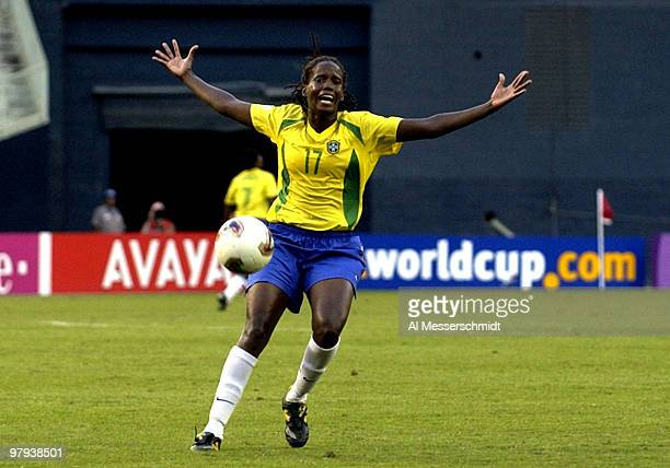 Brazil forward Katia questions a call at midfield Wednesday, September 24, 2003 at RFK Stadium, Washington D. C., during the opening round of the...