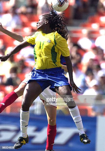 Brazil forward Katia, who scored a goal, heads a ball Saturday, September 27, 2003 at RFK Stadium, Washington, D. C., during the opening round of the...