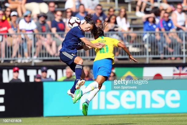 Brazil forward Marta and Japan defender Aya Sameshima in action during a friendly match between Japan and Brazil on July 29 at Pratt Whitney Stadium...