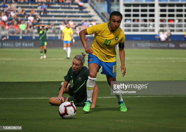 Brazil forward Marta beats Australia defender Alanna Kennedy in the second half of a women's soccer match between Brazil and Australia in the 2018...