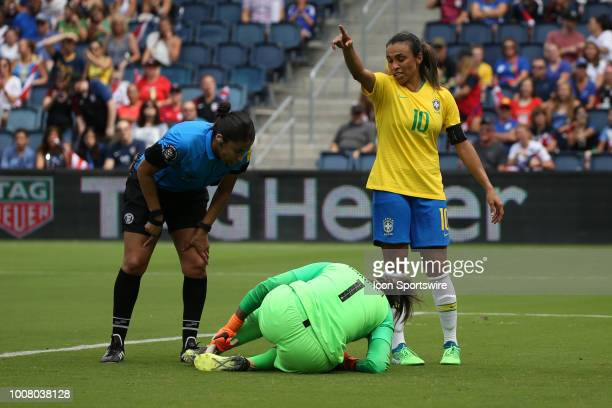 Brazil forward Marta complains to the referee about contact with goalkeeper Barbara during a goal by Australie midfielder Tameka Butt in the first...