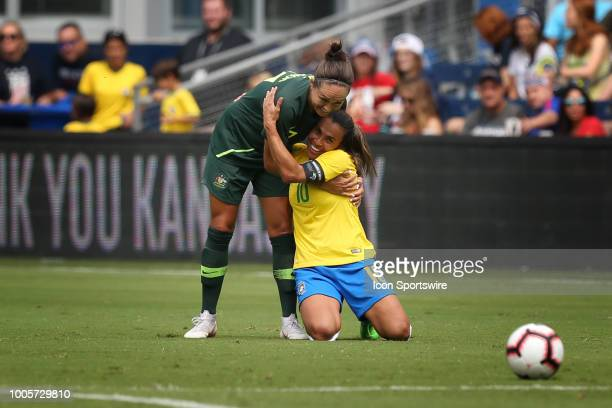 Brazil forward Marta gets a hug from Australia forward Kyah Simon after a foul on Simon in the first half of a women's soccer match between Brazil...