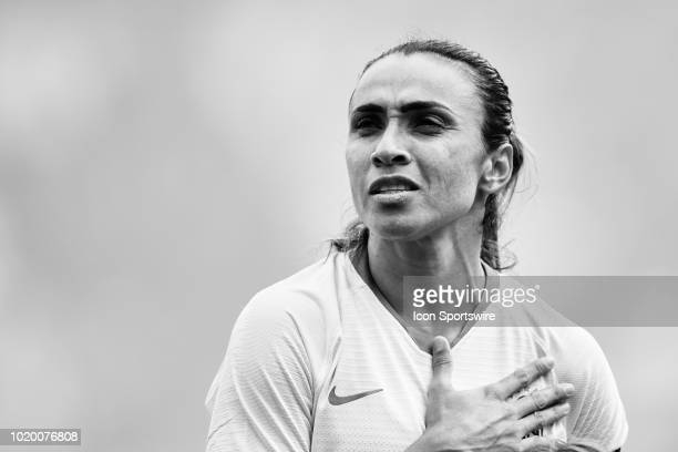 Brazil forward Marta looks on during the national anthem prior to the start of game action during a Tournament of Nations match between Brazil vs...
