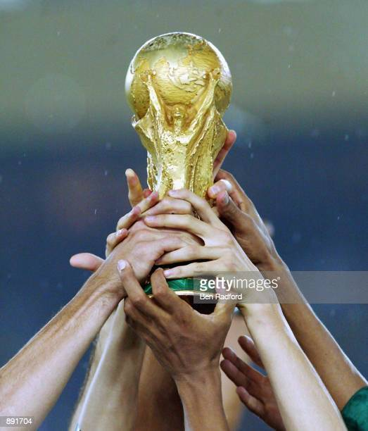 Brazil get their hands on the trophy after the Germany v Brazil World Cup Final match played at the International Stadium Yokohama in Yokohama Japan...