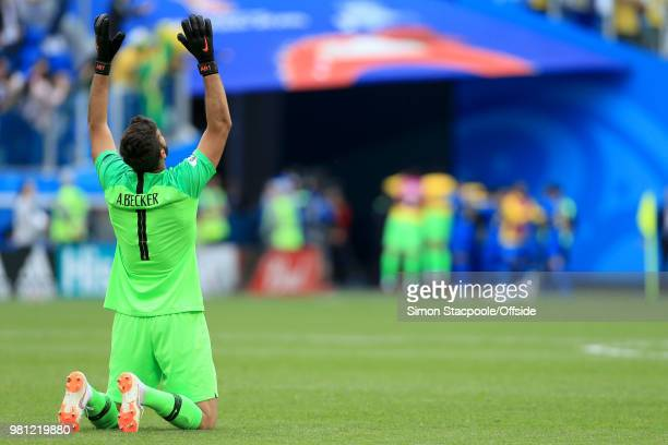 Brazil goalkeeper Alisson Becker drops to his knees and looks skyward as Brazil win 20 during the 2018 FIFA World Cup Russia Group E match between...