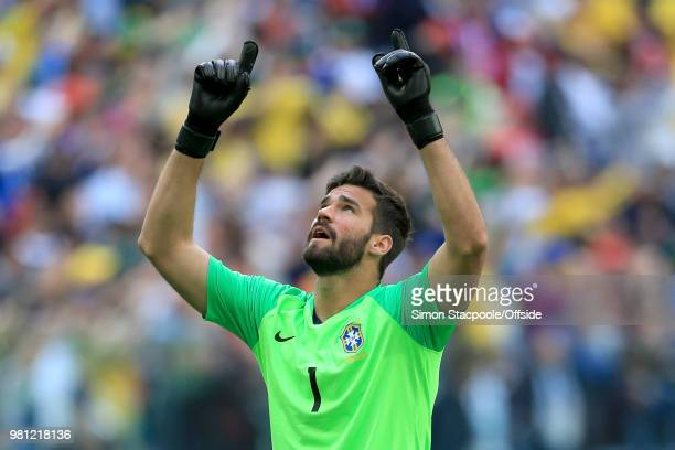 Brazil goalkeeper Alisson Becker points skywards as he celebrates their 20 win during the 2018 FIFA World Cup Russia Group E match between Brazil and...