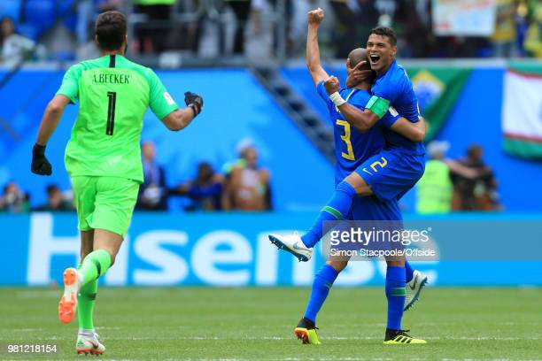 Brazil goalkeeper Alisson Becker runs to celebrate with Miranda of Brazil and Thiago Silva of Brazil after they win 20 during the 2018 FIFA World Cup...