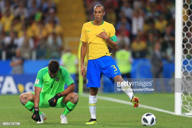 Brazil goalkeeper Alisson Becker takes a rest as Miranda of Brazil kicks a flat ball off the pitch during the 2018 FIFA World Cup Russia Group E...