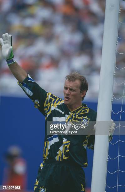 Brazil goalkeeper Claudio Taffarel raises one arm in the air as he guards his near post during play in the 1994 FIFA World Cup quarterfinal match...