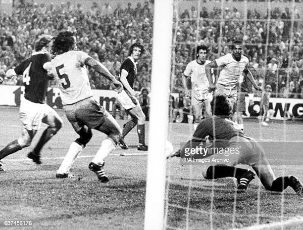 Brazil goalkeeper Leao saves a header from Scotland's Joe Jordan as Scotland's Billy Bremner and Brazil's Piazza battle for the loose ball watched by...