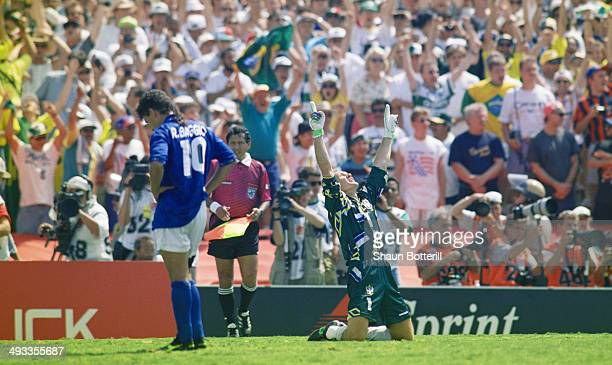 Brazil goalkeeper Taffarel celebrates after Roberto Baggio of Italy had missed his penalty to decide the FIFA World Cup Final 1994 between Brazil and...