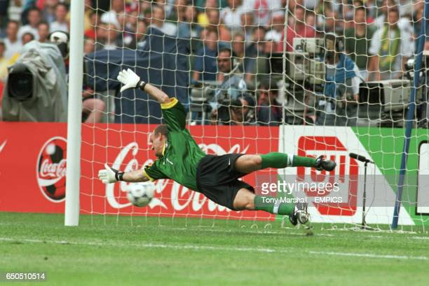 Brazil goalkeeper Taffarel fails to stop Scotland's John Collins from scoring the equalising goal from the penalty spot